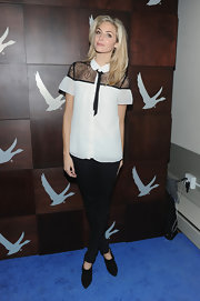 Tamsin Egerton wore a white chiffon button-down shirt with lace shoulders at the Grey Goose Blue Door 'Look of Love' party.