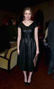 Though clad in black leather, Greta Gerwig still looked very feminine at the Grey Goose pre-Oscar party.