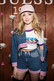 Peyton List worked a colorful Guess ensemble, consisting of a crop-top and matching denim jacket and shorts, during the brand's fragrance launch.