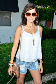 Camilla Belle accessorized with a cute pair of orange-rimmed sunnies by Tory Burch for the Guess Hotel event.