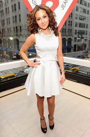 Adrienne Bailon styled her honey-blond locks in soft ringlet curls at the grand opening of Guess on 5th Avenue.