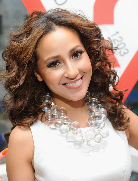 Adrienne Bailon amped up her look with flirty false lashes at the Guess store opening on 5th Avenue.