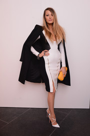 Blake Lively arrived for the Gabriela Cadena fashion show rocking a skintight dress, which she tamed with a black wool coat.