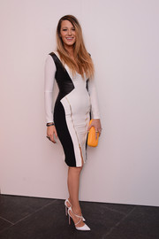 Blake Lively paired her sexy dress with classy white cross-strap pumps by Christian Louboutin.