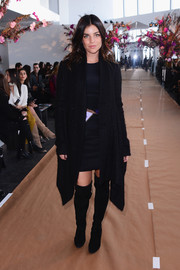 Julia Restoin-Roitfeld kept warm in edgy-sexy style with a pair of black thigh-high boots.