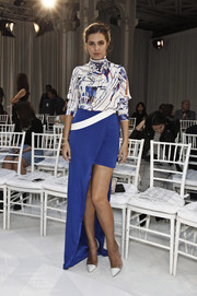 Amber Le Bon paired her blouse with a blue high-low skirt.