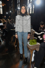 Leandra Medine dressed down her jacket with a pair of blue jeans.