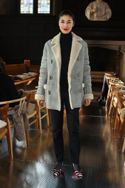 Caroline Issa teamed her jacket with a pair of tapered slacks.