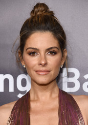 Maria Menounos wore her hair in a loose top knot at the Angel Ball 2017.