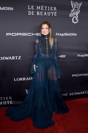 Danielle Bernstein commanded attention in a sheer blue military-inspired gown by Roberto Cavalli at the Angel Ball 2016.