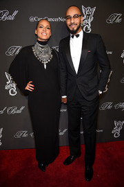 Alicia Keys looked exotic at the Angel Ball in a long-sleeve black maternity dress styled with a silver statement necklace.