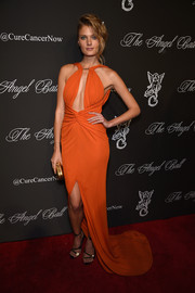 Constance Jablonski looked seductive at the Angel Ball in a red-orange halter gown with a sexy keyhole neckline and a thigh-high slit.