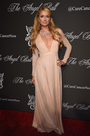 Paris Hilton looked bold yet classy at the Angel Ball in a nude Gabriela Cadena gown with a deep-V plunge.