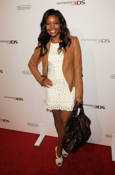 Gabrielle Union Leather Jacket [nintendo hosts exclusive launch event,clothing,red carpet,thigh,leg,carpet,fashion,cocktail dress,fashion model,dress,fashion design,nintendo 3ds,gabrielle union,hollywood,california,siren studios,launch event]