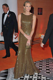 Charlene sparkled at the 69th Grand Prix Gala in Monaco wearing a sequin saturated bronze evening gown.