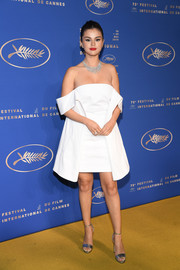 Selena Gomez looked alluring in an off-the-shoulder LWD by Louis Vuitton at the 2019 Cannes Film Festival gala dinner.
