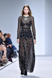 Gigi Hadid showed some skin in a sheer, honeycomb-patterned maxi dress at the Giambattista Valli fashion show.