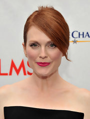 Julianne Moore wore her hair in a sleek French twist with long side-swept bangs at the premiere of 'Game Change.'