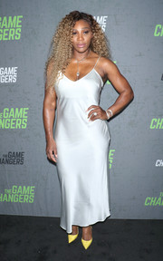 Serena Williams made an appearance at the New York premiere of 'The Game Changers' wearing a slinky silver slip dress.