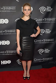Natalie Dormer chose a black loose blouse to pair with her sexy leather skirt at the exhibit opening for 'Game of Thrones.'