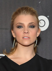 Natalie Dormer chose a funky claw-shaped earring to add a touch of edge to her red carpet look.