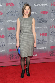 Carrie Coon added an edgy-chic touch with a pair of black ankle boots.
