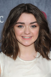 Maisie Williams attended the 'Game of Thrones' season 4 premiere wearing her hair in high-volume waves.
