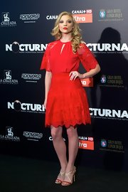 A vibrant apple red lace frock made Natalie Dormer's matching red lips pop!