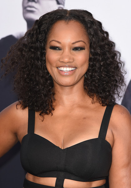 Garcelle Beauvais Medium Curls [straight outta compton,hair,brassiere,undergarment,clothing,hairstyle,beauty,black hair,lip,long hair,garcelle beauvais,arrivals,california,los angeles,microsoft theater,legendary pictures,universal pictures,premiere,premiere]