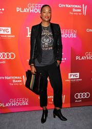 Aisha Tyler chose a black satin-trimmed pantsuit, which she dressed down with a graphic tee, for the Backstage at the Geffen Fundraiser.