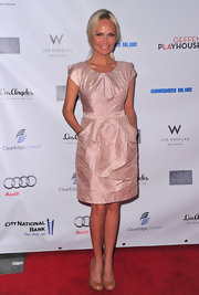 Kristin Chenoweth teamed her ladylike blush shift with nude patent pumps.