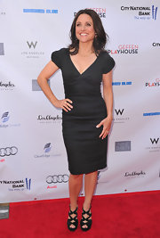 Julia Louis-Dreyfus paired black strappy sandals with her LBD for a sexy finish.