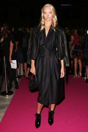 Gemma Ward arrived for the YSL beauty launch wearing a black leather jacket over a tux dress.