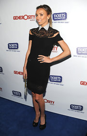 Giuliana Rancic paired her black collared dress with matching platform peep toes.