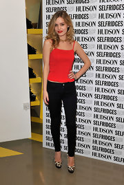 Georgia rocks skinny black jeans with a red tank for the Hudson jeans photo call in London.
