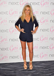 Geri got playful in a navy romper with nude accessories for her swimwear launch.