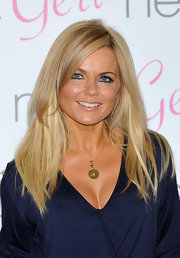 Geri Halliwell launched her swimwear collection showing off platinum blond tresses. A few low-lights rounded out her beach babe look.