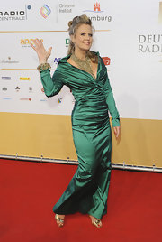 Barbara Schoeneberger proved that satin never goes out of style with this emerald long-sleeve gown at the German Radio Awards.