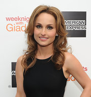 Giada De Laurentiis attended the launch of her new cookbook 'Weeknights with Giada' wearing her long hair in tousled curls.