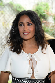 Salma Hayek wore a casual wavy style at the Giambattista Valli fashion show.