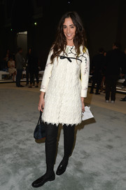 Clotilde de Kersauson went for vintage charm in a textured, bow-adorned white coat at the Giambattista Valli fashion show.