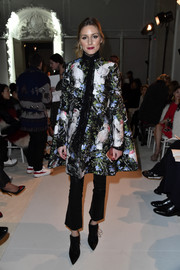 Olivia Palermo looked very classy in a floral A-line coat by Giambattista Valli while attending the label's Haute Couture show.