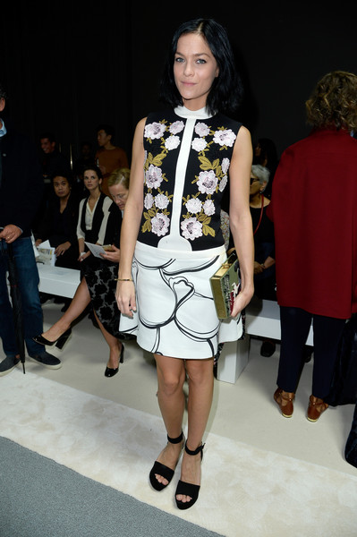 Leigh Lezark paired her dress with an equally cute Olympia Le-Tan book clutch.