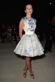 Sarah Close cut an ultra-girly silhouette in this floral fit-and-flare dress during the Giambattista Valli Couture fashion show.