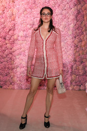 Shailene Woodley flashed her legs in a red tweed mini dress by Giambattista Valli during the brand's Fall 2020 show.