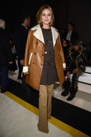 Olivia Palermo donned a retro-chic brown and white leather coat for the Giambattista Valli fashion show.