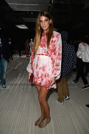 Bianca Brandolini D'Adda chose a drapey red and white printed mini for the Giambattista Valli Couture fashion show.