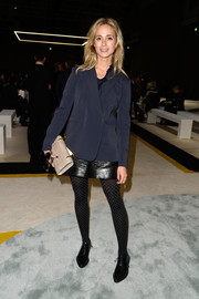 Elisabeth von Thurn und Taxis covered up in a navy boyfriend blazer for the Giambattista Valli fashion show.