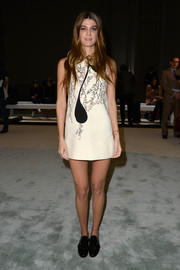 Bianca Brandolini was all legs in a cream-colored floral mini dress during the Giambattista Valli fashion show.