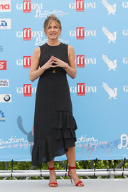 Jennifer Aniston was sweet and stylish in a star-print ruffle dress by Tibi at the Giffoni Film Festival.